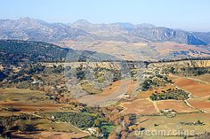 Photo about A view upon Ronda fields taken in december 2015 around Christmas time. It s a MUST-VISIT place if you like to hike! Image of farm, fields, building - 70321390 Andalusia Spain, Christmas Time, Fields, Grand Canyon, December, Hiking, Stock Photos, Places, Travel