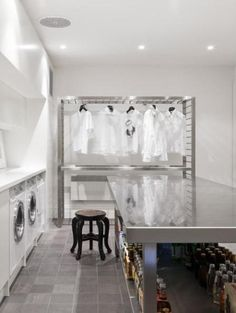 simple bright modern laundry with lots of stainless steel and white cabinets desire bright modern laundry room