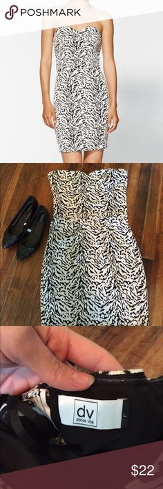 DV Dolce Vida Audreya animal Print Dress SZ L DV Dolce Vida Audreya animal Print Dress SZ L. 84% poly 15% rayon. Gorgeous strapless dress with sweetheart neckline. Size large zero flaws Dolce Vita Dresses Mini