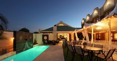 The four-star Feathers Boutique Hotel is an award-winning boutique hotel situated in the beautiful suburb, Durbanville of Cape Town, South Africa. This comfortable guest house accommodation is just 33 minutes from the busy city centre making it the ideal Clifton Beach, Cape Town Hotels, Conference Facilities, Luxury Apartments, South Africa, Swimming Pools, Feathers, Boutique, Mansions