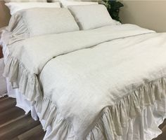 """Linen Ticking Stripe Mermaid Long Ruffle Duvet Cover  This comfortable and charm duvet cover with mermaid long ruffle style is an effortless must have for any shabby chic room. Luxuriously soft yet practical. Handmade in linen ticking stripe fabric, featuring 8"""" effortless flow ruffle edges. Ticking striped linen is weaved in undyed natural linen and soft white yarn.   http://www.superiorcustomlinens.com/linen-ticking-stripe-mermaid-long-ruffle-duvet-cover/  #shabbychic #shabbych.."""