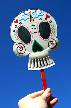 Paper Plate Calavera cut holes for eyes and it could be a mask or use elastic string so it stays on their face !  party hat alternative use tissue paper for flames
