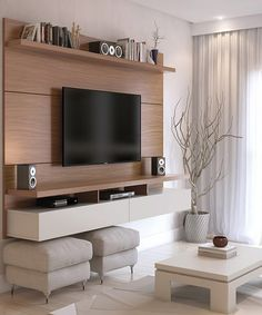 This entertainment center gives the illusion that your TV and electronics are floating on thanks to a wall-mounted design that lends modern flair to home furnishings. Multiple shelves stash accessories, and media holes help manage and hide wires.
