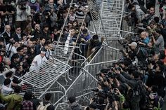 Authorities remove a barricade outside the Citic Tower near a protest site in the Admiralty...