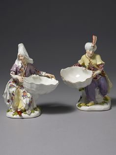 An extremely rare pair of Meissen Figural Turkish Sweetmeat Stands An extremely rare pair of Meissen Figural Turkish Sweetmeat Stands, modelled by J.F. Eberlein, both figures seated on rocky outcrops, raised up on irregularly moulded bases applied with brightly coloured flowers and leaves, each holding a scallop shell. The male ... Read More