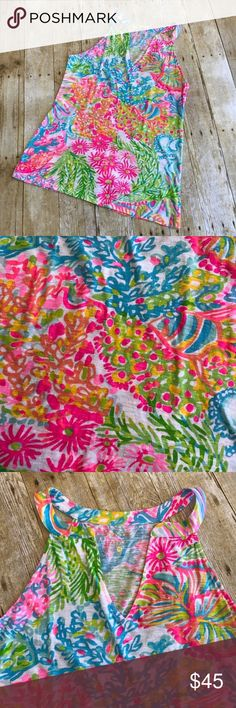 """Lilly Pulitzer Arya Top in Lovers Coral NWOT! Never worn! Lilly Pulitzer Arya Top in Lovers Coral. Sleeveless. Racerback styling. 100% cotton. Size Medium. Measures approximately 16.5"""" across at bust, 25"""" from shoulder to hem. From a smoke free home! Lilly Pulitzer Tops"""