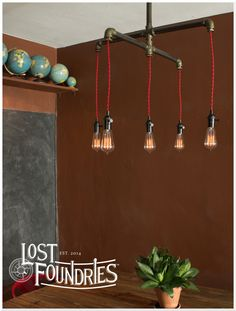 Industrial pipe cross chandelier, Gramme. From Lost Foundries.