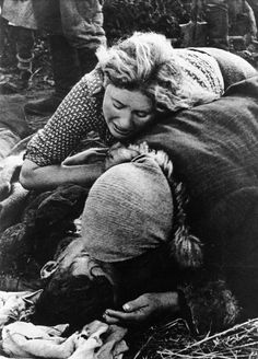 "Women of a small Russian village mourn over those killed by the Germans, 1943—the photograph was given the title ""Victims of Fascist Terror"" by its photographer."