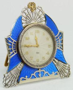 Antique Russian silver 84 desk clock with blue guilloche enamel design with gold numbers and notches, and gold hour and minute hands,1895
