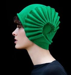 A gorgeous green cloche hat by Behida Dolić