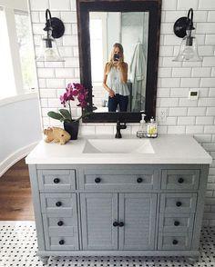 bathroom white subway tiles behind vanity