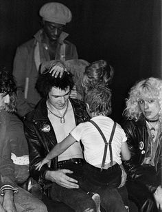 Mandatory Credit: Photo by Ray Stevenson/REX Shutterstock (581295ax) Sid Vicious with children and Nancy Spungen Various