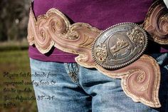 Beautiful up-cycled belt that showcases stitching from old boot tops - by Re-Ride Stories.