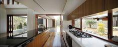 I likethe white kitchen bottom units with the window and wood units above   One Wybelenna by Shaun Lockyer Architects