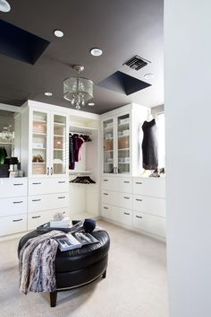 With lots of storage solutions and a bit of sparkle, the glamorous master closet makes it easy to find the right outfit for the day.