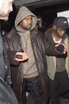 Kanye West wearing Yeezy Season 3 Gloves, Yeezy FW16 Boots, Yeezy Season 3 Contrast Pants, Yeezy Season 3 Oversized Coat