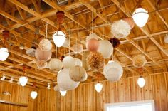 Fun variety of ceiling decorations for a barn. Not the typical you see.