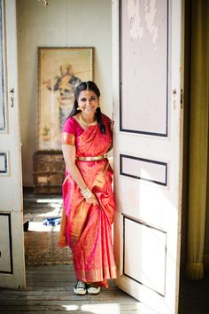 A quirky South Indian bride in an elegant silk saree, traditional gold jewelry...and converse shoes!