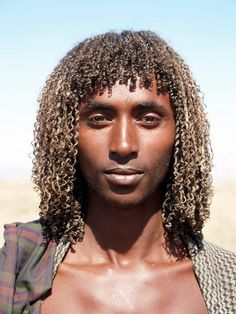 Beja man from sudan. Amazing picture.