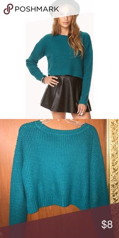 F21 Cropped Waffle Knit Sweater A waffle knit cropped sweater featuring vented sides. Round neckline. Long sleeves. Ribbed trim. Forever 21 Tops