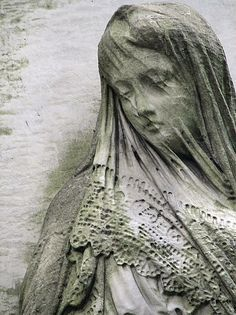 Warsaw. Powązki. Tomb sculpture - woman with a veiled face ...