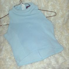 Baby Blue Crop Top! This sleeveless light blue crop top comes down longer towards the back. It's simple & cute! **Size Small** Missguided Tops Crop Tops