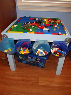 DIY Lego Table: $8 Ikea side table (4) $5 base plates from Amazon = $28 I also like the towel rod with the hanging lego cups.
