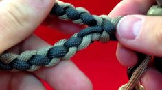It's a diamond (or spiral) braid -- like gimp, but with paracord. Cool! Paracordist How to Make a Four Strand Round Braid Loop - w/ 4 strands out