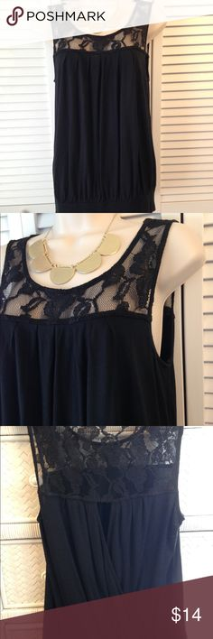 "EXPRESS BLACK TANK WITH LACE YOKE EUC EXPRESS BLACK TANK WITH LACE UOKE AND KNIT BODICE. KEYHOLE WRAP BACK. Yoke polyester/spandex. Bodice Rayon. Banded hem. Measures 25"" from shoulder to hem. 18"" flat across bust. EUC Express Tops Tank Tops"