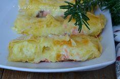 Rustico di sfoglia con salmone patate e mozzarella, buono facile e veloce, la sfoglia friabile racchiude un cuore morbido di patate salmone e mozzarella