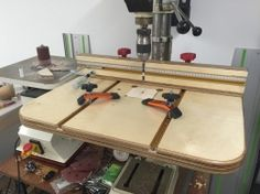 Drill Press Table - Homemade drill press table constructed from Baltic birch plywood, T-tracks, plastic pipe, threaded rod, knobs, and hardware.