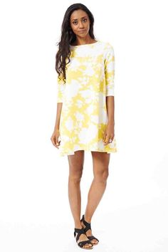 Pretty Yellow Swing Dress. Brighten up your day with this pretty swing dress!   It totally brings out the summer look! Simply team up with sandals and a handbag to complete the look!   It has a round neckline and 3/4 sleeves. Hurry up ladies and grab this dress for only £22.99!