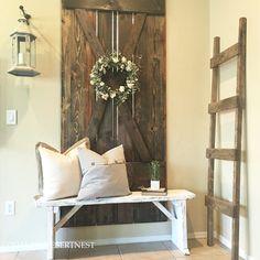 Farmhouse style decor. Barn door and rustic bench.