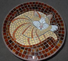 mosaic cat stepping stone                                                                                                                                                      More
