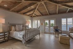 A bedroom in Billy Joel's Florida house  ( selling for 27 millions)   A great view to wake up to: Above, one of the nine bedrooms on the property. This bedroom is decorated with warm browns and taupes