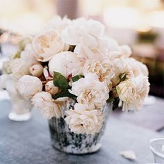 Brides: Elizabeth and Lee in Ojai, CA. Adorning the reception table is a muted arrangement of garden roses.