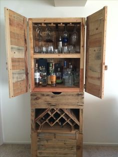My liquor cabinet is finally finished! Every pic on this board contributed to the making of this... A couple hours at a time, over the last year with mostly hand tools and a crapload of pallets. Done!