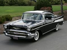 1957 Chevrolet Bel Air Sport Coupe. Johnny's was black. My DADDY also had one in black when I was in grade school.