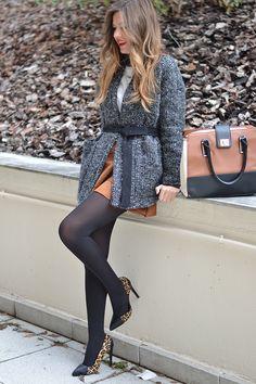 Cardigan, brown suede skirt, black opaque tights, leopard heels. Chic!
