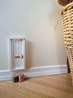 """tinydoor  via Loobylu via """"We are not alone…(fairy doors)""""  (via designsponge)."""