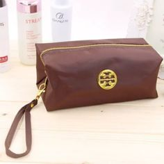 Cosmetic Bag For your consideration is a brand new cosmetic bag with gold toned hardware and detachable strap. Bags Cosmetic Bags & Cases