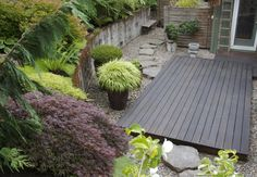 Like the clean rectangle of decking on gravel. No curves to cut and could do pebbles rather than rocks.