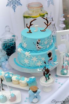 #frozen #cake with #frozen themed #cupcakes by elegant kids events