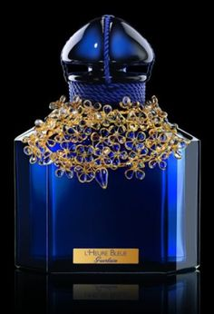 L'Heure Bleue 100 Anniversaire Guerlain.  Main Accords: floral, powdery, aromatic, woody, citrus and warm spicy.
