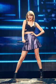 Sensational: Taylor put her taut figure on display in a thigh-skimming mini-skirt and crop-top