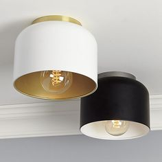 These look really good and are really cheap.  Do you need any more lights in your apartment?   bell black flush mount lamp  | CB2