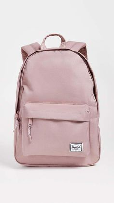 Herschel Supply Co. Classic Mid Volume Backpack Fabric: Ballistic weave Zip at top Zip exterior pockets Shoulder straps Lined Weight: / Imported, Vietnam Measurements Height: / Length: / Depth: / Mochila Herschel, Herschel Rucksack, Cute Backpacks For School, Trendy Backpacks, College Backpacks, Pink Backpacks, Cute School Bags, Canvas Backpacks, Leather Backpacks
