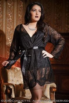 3708X Robe1 PC. Stretch lace robe with full length sleeves, a removable satin ribbon tie and trimmed with satin binding. This robe has been lengthened for a more flattering fit.  Black  OS/XL  Shown with:  Bustier (3730X)  Booty Short (101)  Stockings (1706)