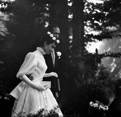 Audrey Hepburn and Mel Ferrer on their wedding day in Bürgenstock, Switzerland, September 25, 1954. Audrey's dress was designed by French fashion designer Pierre Balmain.