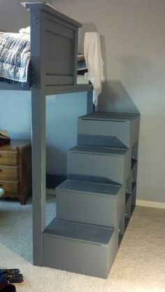 Stairs up to the loft bed with storage in each step and cubbies underneath!